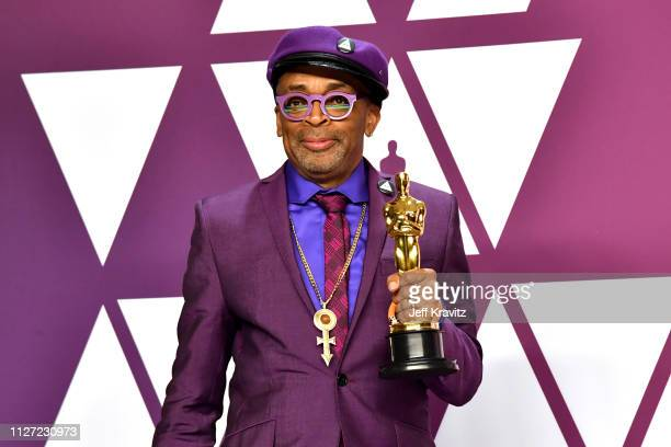 "Director Spike Lee poses with the Best Adapted Screenplay award for ""BlacKkKlansman"" in the press room during at Hollywood and Highland on February..."