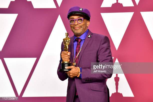 Director Spike Lee poses with the Best Adapted Screenplay award for BlacKkKlansman in the press room during at Hollywood and Highland on February 24...
