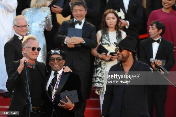 TOPSHOT US director Spike Lee poses with the Grand Prix award he received for the film 'BlacKkKlansman' between British singer Sting and Jamaican...