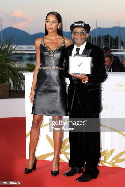 Director Spike Lee posing with the Grand Prix award for 'BlacKkKlansman' and Laura Harrier next to him at the Palme D'Or Winner Photocall during the...