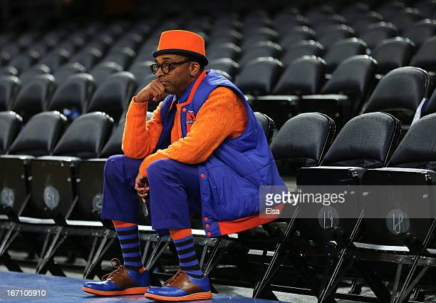 Director Spike Lee sits in his seat prior to the game between the Boston Celtics and the New York Knicks during Game One of the Eastern Conference...