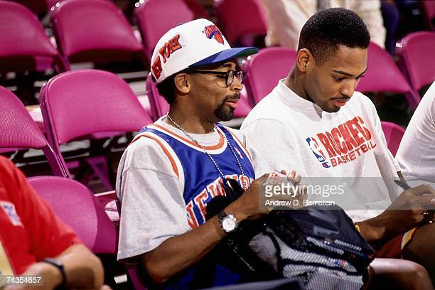 Director Spike Lee talks with Robert Horry of the Houston Rockets prior to Game Five of the NBA Finals played on June 17 1994 at Madison Square...