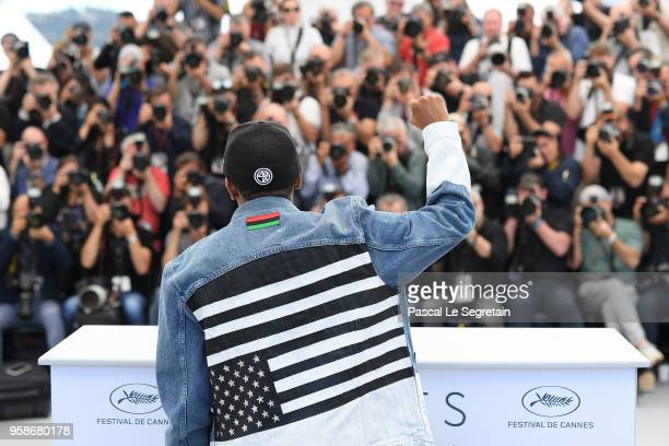Director Spike Lee wears an upside down American flag on his jacket as he attends the photocall for BlacKkKlansman during the 71st annual Cannes Film...