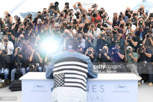 """Director Spike Lee wears an upside down American flag on his jacket as he attends the photocall for """"BlacKkKlansman"""" during the 71st annual Cannes..."""