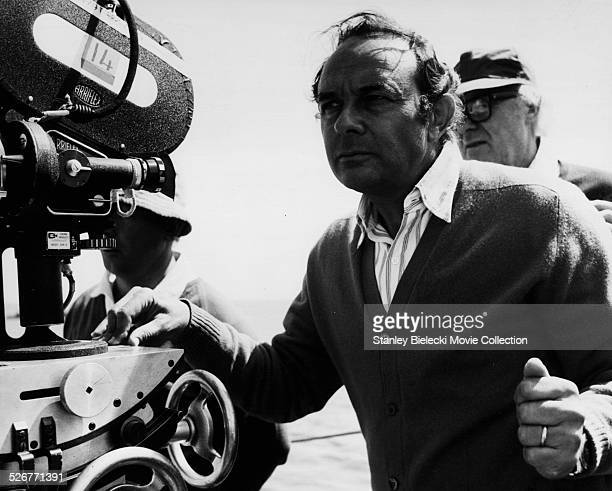 Director Stanley Donen in front of cinematographer Geoffrey Unsworth on the set of the movie 'Lucky Lady' 1975