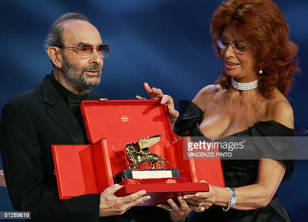 US director Stanley Donnen receives the Golden Lion for his career from Italian movie star Sophia Loren during the award ceremony at the historic...