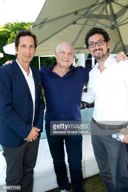 Director Stephane Foenkinos Editorinchief of TV5 Monde Patrick Simonin and Writer director David Foenkinos attend the 10th Angouleme FrenchSpeaking...