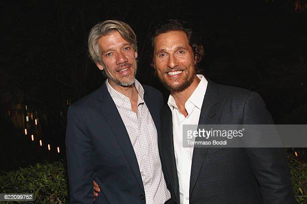 Director Stephen Gaghan and actor Matthew McConaughey attend the TWCDimension celebrates the Cast and Filmmakers of Gold at the private residence of...