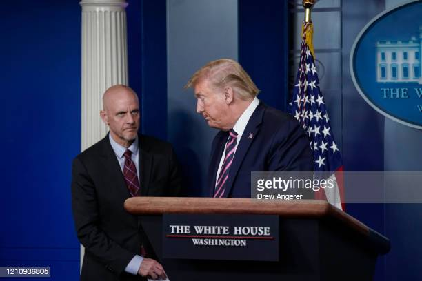 Director Stephen Hahn looks on as U.S. President Donald Trump leaves the lectern during the daily coronavirus task force briefing at the White House...