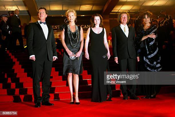 Director Stephen Hopkins and actors Charlize Theron wearing Chopard jewelry Emily Watson Geoffrey Rush and Sonia Aquino leave The Life And Death Of...
