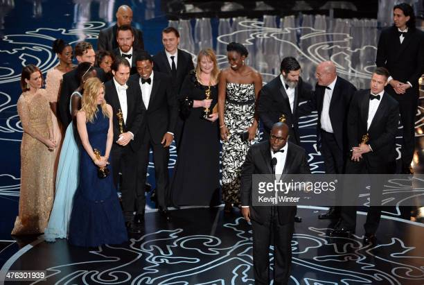 Director Steve McQueen accepts the Best Picture award for '12 Years a Slave' with actors Sarah Paulson Benedict Cumberbatch Lupita Nyong'o...