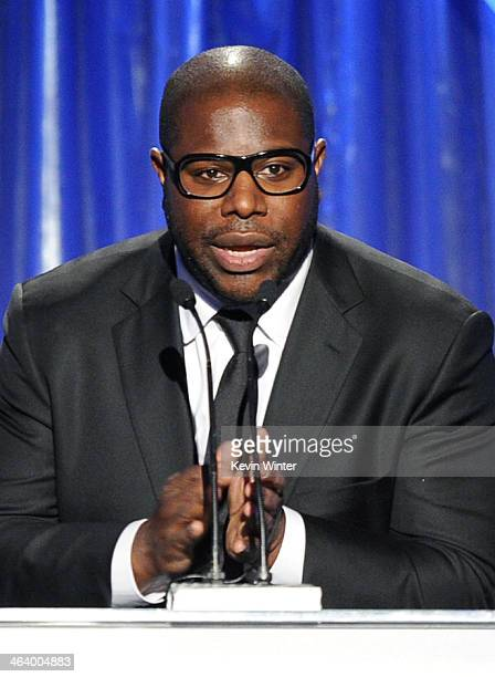 Director Steve McQueen accepts the Darryl F Zanuck Award for Outstanding Producer of Theatrical Motion Pictures for '12 Years a Slave' onstage during...