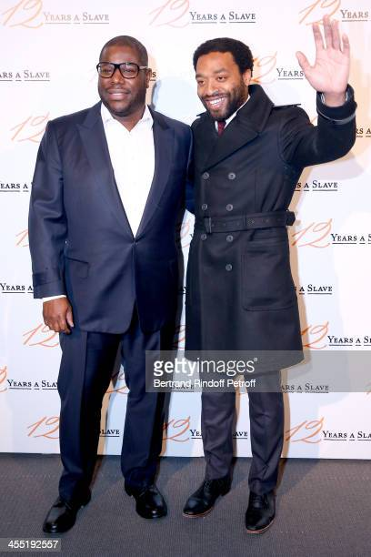 Director Steve McQueen and actor Chiwetel Ejiofor attend the '12 Years a Slave' movie Premiere at Cinema UGC Normandie on December 11 2013 in Paris...