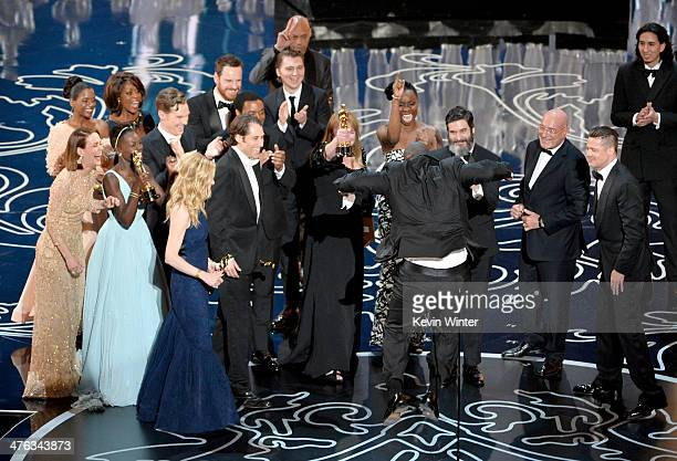Director Steve McQueen celebrates the Best Picture award for '12 Years a Slave' with actors Sarah Paulson Benedict Cumberbatch Lupita Nyong'o...