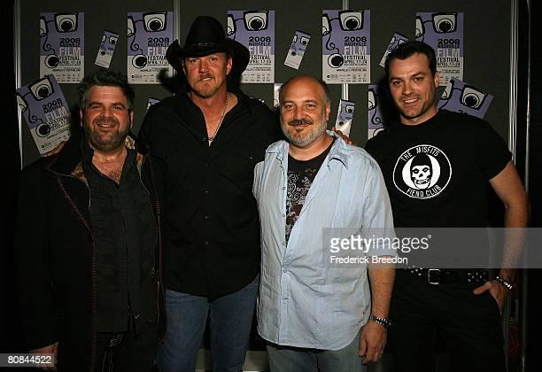 Director Steven Goldman poses with actor and country music singer Trace Adkins composer Alan Brewer and actor Myk Watford prior to a screening of...