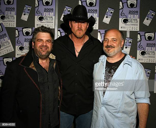 Director Steven Goldman poses with actor and country music singer Trace Adkins and composer Alan Brewer prior to a screening of 'Trailer Park of...