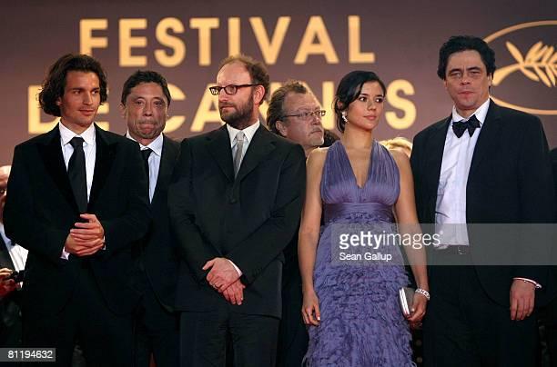 "Director Steven Soderbergh, actress Catalina Sandino Moreno and actor Benicio Del Toro depart the ""Che"" premiere at the Palais des Festivals during..."