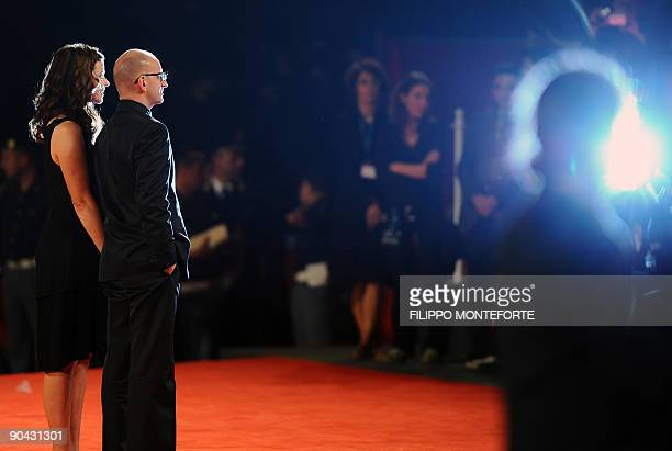 """Director Steven Soderbergh and his wife Jules Asner arrive for the screening of """"The Informant!"""" at the Venice film festival on September 7, 2009...."""