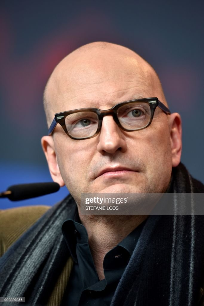 US director Steven Soderbergh listens during a press conference for the film 'Unsane' presented in competition during the 68th edition of the Berlinale film festival in Berlin on February 21, 2018. / AFP PHOTO / Stefanie Loos