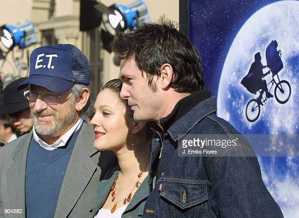 Director Steven Spielberg actress Drew Barrymore and actor Henry Thomas attend the premiere of the 20th anniversary version of Spielberg's movie ET...