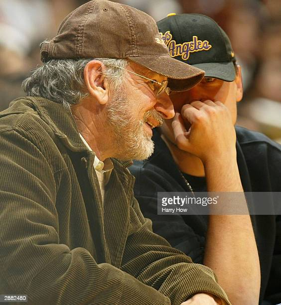 Director Steven Spielberg and actor Leonardo DiCaprio chat courtside during the Phoenix Suns game against the Los Angeles Lakers on January 19 2004...