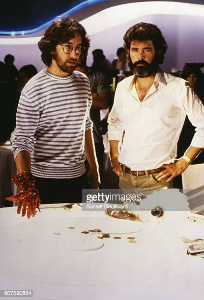 """Director Steven Spielberg and producer George Lucas on the set of """"Indiana Jones and the Temple of Doom""""."""