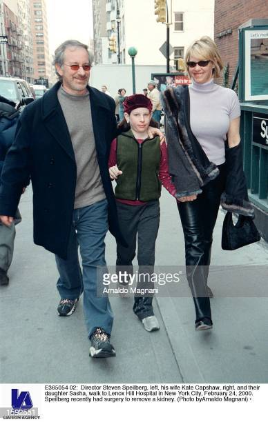 Director Steven Spielberg left his wife Kate Capshaw right and their daughter Sasha walk to Lenox Hill Hospital in New York City February 24 2000...