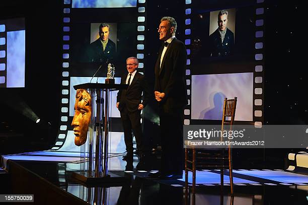 Director Steven Spielberg presents honoree Daniel DayLewis with the Stanley Kubrick Britannia Award for Excellence in Film onstage at the 2012 BAFTA...