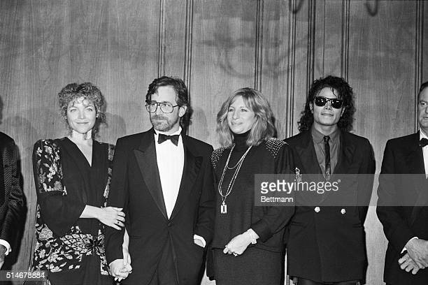Director Steven Spielberg stands with his wife Amy Irving Barbra Streisand and Michael Jackson on December 14 1986 Spielberg is receiving the Scopus...