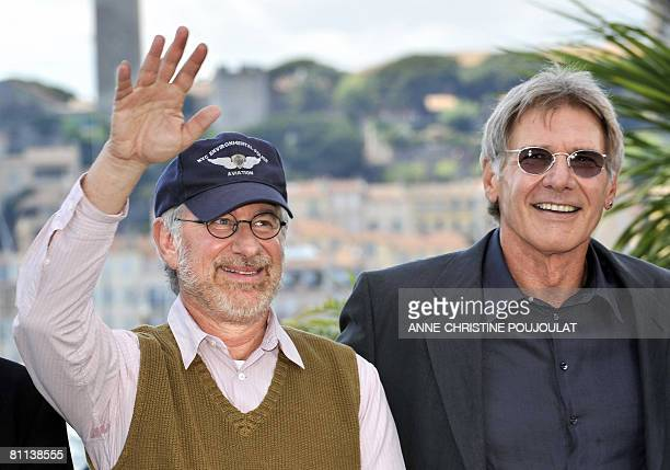 US director Steven Spielberg waves as he poses with actor Harrison Ford during a photocall for his film 'Indiana Jones 4' at the 61st Cannes...