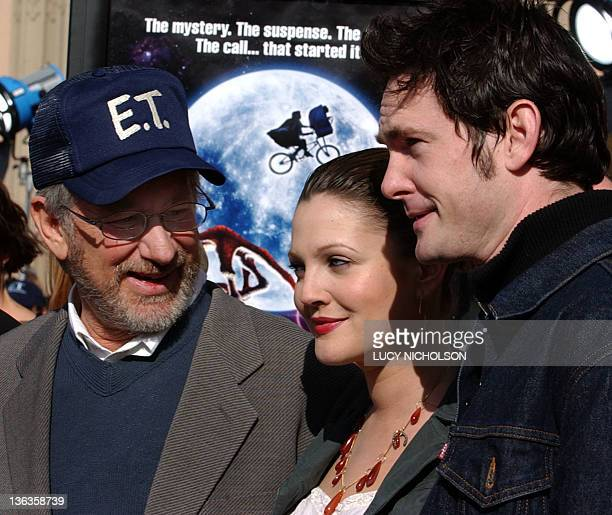 US director Steven Spielberg welcomes original cast members Drew Barrymore and Henry Thomas to a 20th anniversary version premiere of his film ET The...