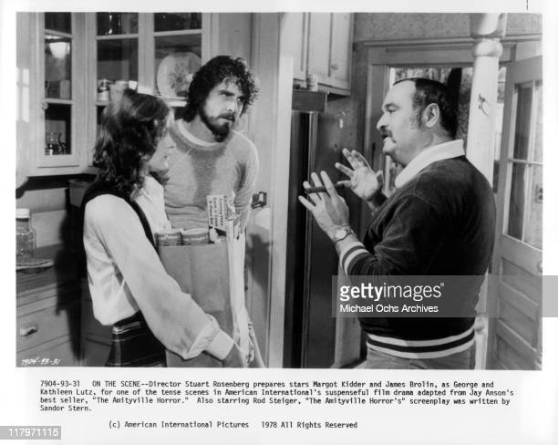 Director Stuart Rosenberg gesturing to actress Margot Kidder and actor James Brolin on the sets of the film 'The Amityville Horror' 1979