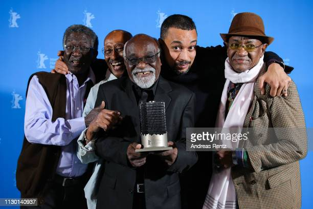 Director Suhaib Gasmelbari and protagonists of the documentary Talking About Trees pose with the Glashütte Original award at the closing ceremony of...