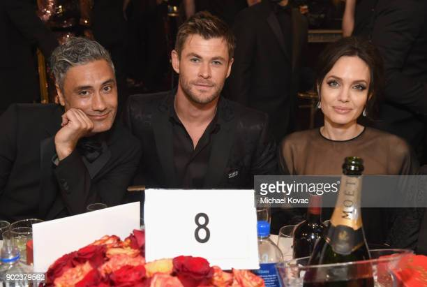 Director Taika Waititi actor Chris Hemsworth and actor/filmmaker Angelina Jolie celebrate The 75th Annual Golden Globe Awards with Moet Chandon at...