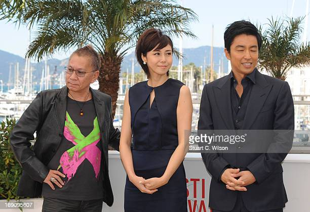 Director Takashi Miike actress Nanako Matsushima and actor Takao Osawa attends the photocall for 'Wara No Tate' at The 66th Annual Cannes Film...