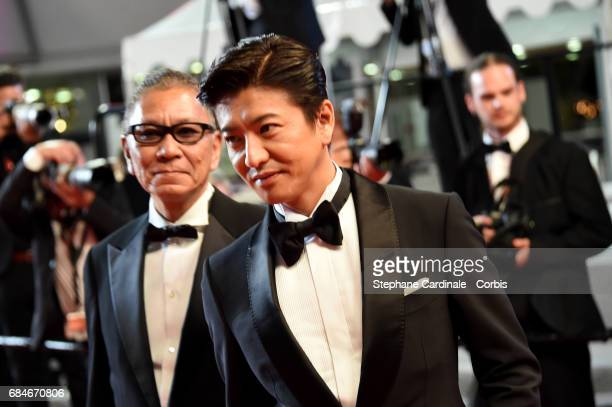Director Takashi Miike and Takuya Kimura attend the 'Blade Of The Immortal ' premiere during the 70th annual Cannes Film Festival at Palais des...