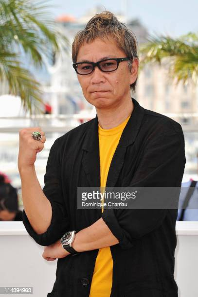 Director Takashi Miike attends the Ichimei Photocall during the 64th Cannes Film Festival at the Palais des Festivals on May 19 2011 in Cannes France