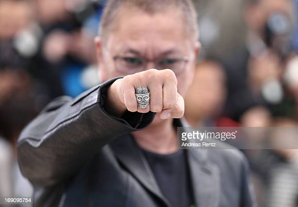 Director Takashi Miike attends the photocall for 'Wara No Tate' at The 66th Annual Cannes Film Festival at Palais des Festivals on May 20 2013 in...