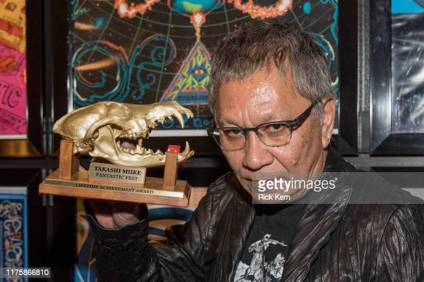 Director Takashi Miike poses with his Fantastic Fest Lifetime Achievement Award during Fantastic Fest at Alamo Drafthouse on September 19 2019 in...