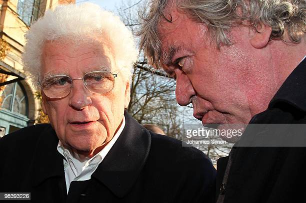 Director Tankred Dorst and writer Tilmann Spengler chat together after the funeral service for Wolfgang Wagner at festival opera house on April 11...