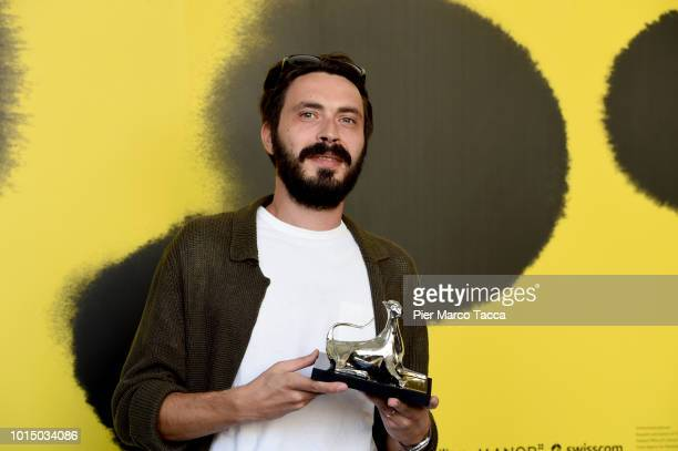 Director Tarik Aktas poses with Pardo for the Best Emerging Director of Filmmakers of the Present Competition at the Palmares photocall during the...