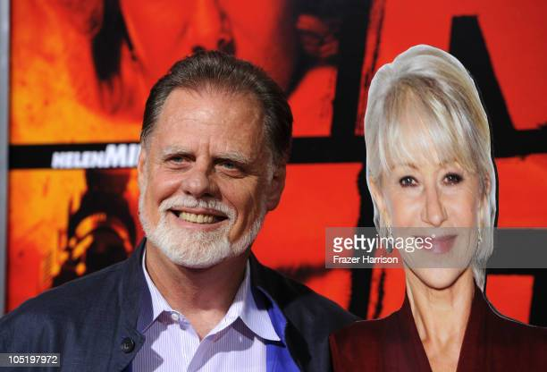 Director Taylor Hackford attends the Red Los Angeles Screening with a cardboard cutout of Helen Mirren at Grauman's Chinese Theatre on October 11...