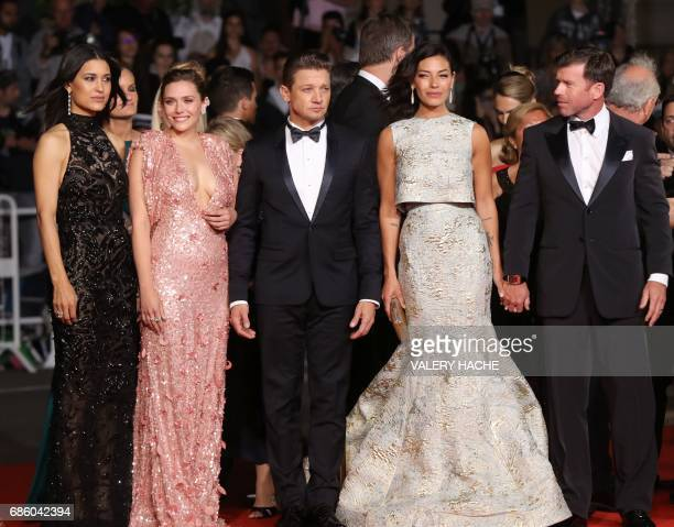 US director Taylor Sheridan his wife Nicole Sheridan and US actress Julia Jones US actress Elizabeth Olsen US actor Jeremy Renner arrive on May 20...