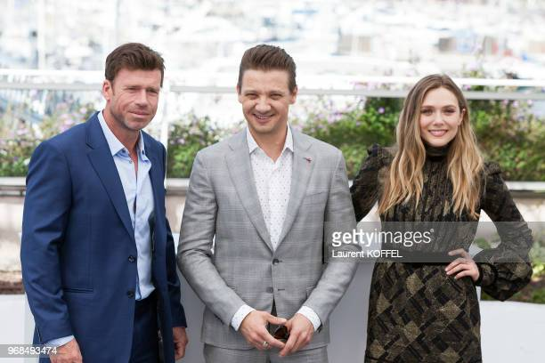 Director Taylor Sheridan Jeremy Renner and Elizabeth Olsen attend the 'Wind River' photocall during the 70th annual Cannes Film Festival at Palais...