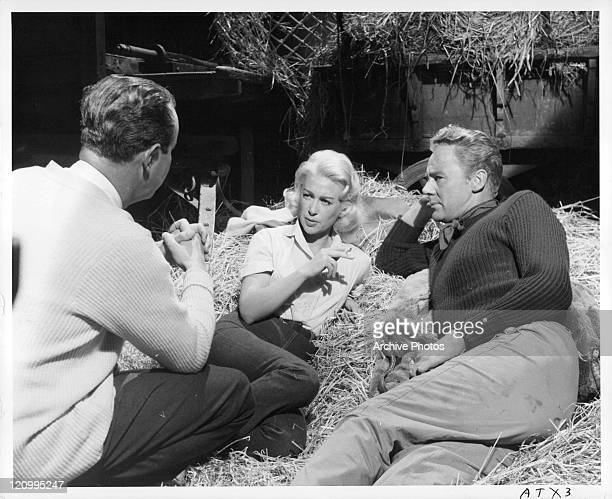Director Terence Young explains to Martine Carol and Van Johnson how he wants the love scene played in offcamera shot from the film 'Action Of The...
