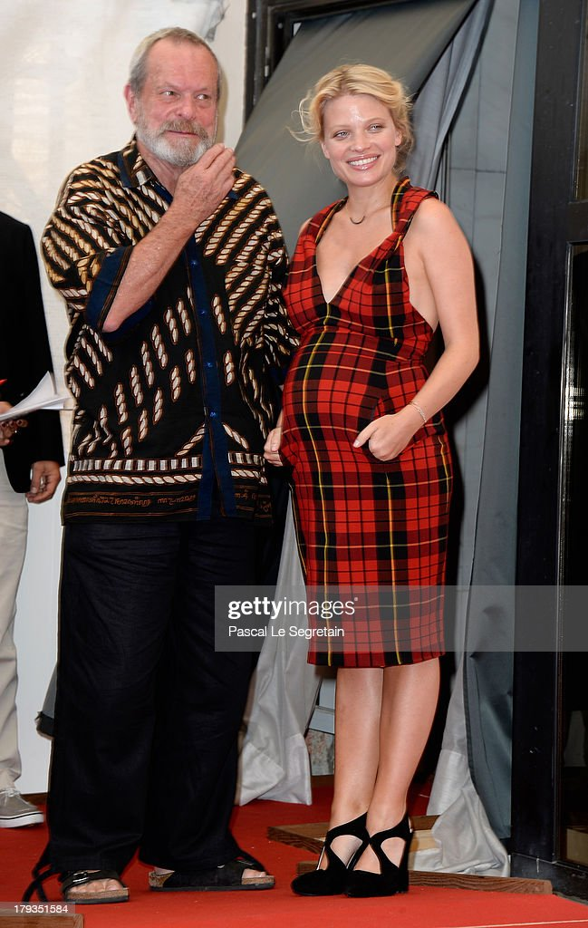 Director Terry Gilliam and actress Melanie Thierry attend 'The Zero Theorem' Photocall during the 70th Venice International Film Festival at the Palazzo del Casino on September 2, 2013 in Venice, Italy.