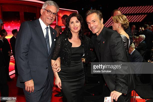 ZDF director Thomas Bellut and his wife and Hannes Jaenicke attend the Ein Herz fuer Kinder Gala 2014 at Tempelhof Airport on December 6 2014 in...