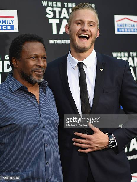 Director Thomas Carter and actor Alexander Ludwig arrive at the premire of Tri Star Pictures' When The Game Stands Tall at the ArcLight Cinemas on...