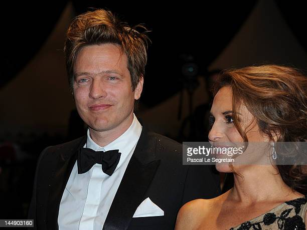 Director Thomas Vinterberg and actress Alexandra Rapaport attend the Jagten Premiere during the 65th Annual Cannes Film Festival at Palais des...