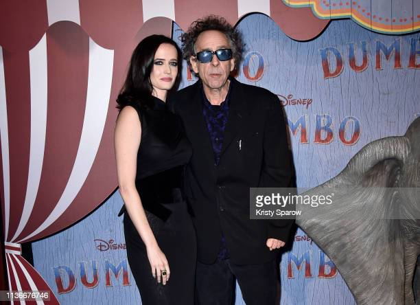 """Director Tim Burton and actress Eva Green attend the """"Dumbo"""" Paris Gala Screening at Cinema Le Grand Rex on March 18, 2019 in Paris, France."""